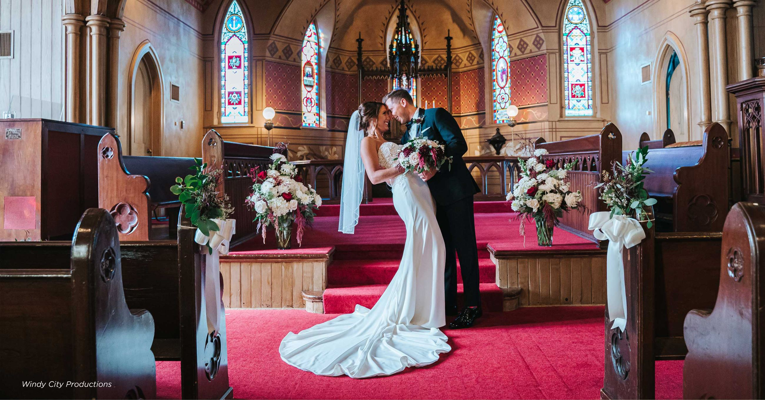 Couple kissing at alter in Century Memorial Chapel
